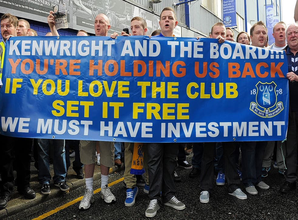 Everton fans protest against chairman Bill Kenwright at Goodison Park during the 2011-12 season