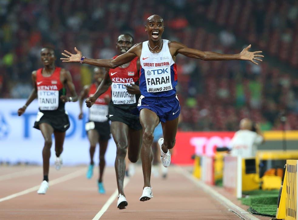 Mo Farah celebrates as he crosses the finish line to win World Championship 10,000m gold