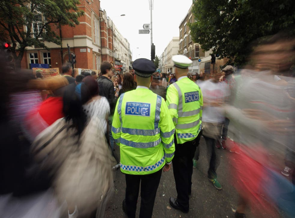 Police officers monitor the crowds at the Notting Hill Carnival on August 29, 2011 in London, England