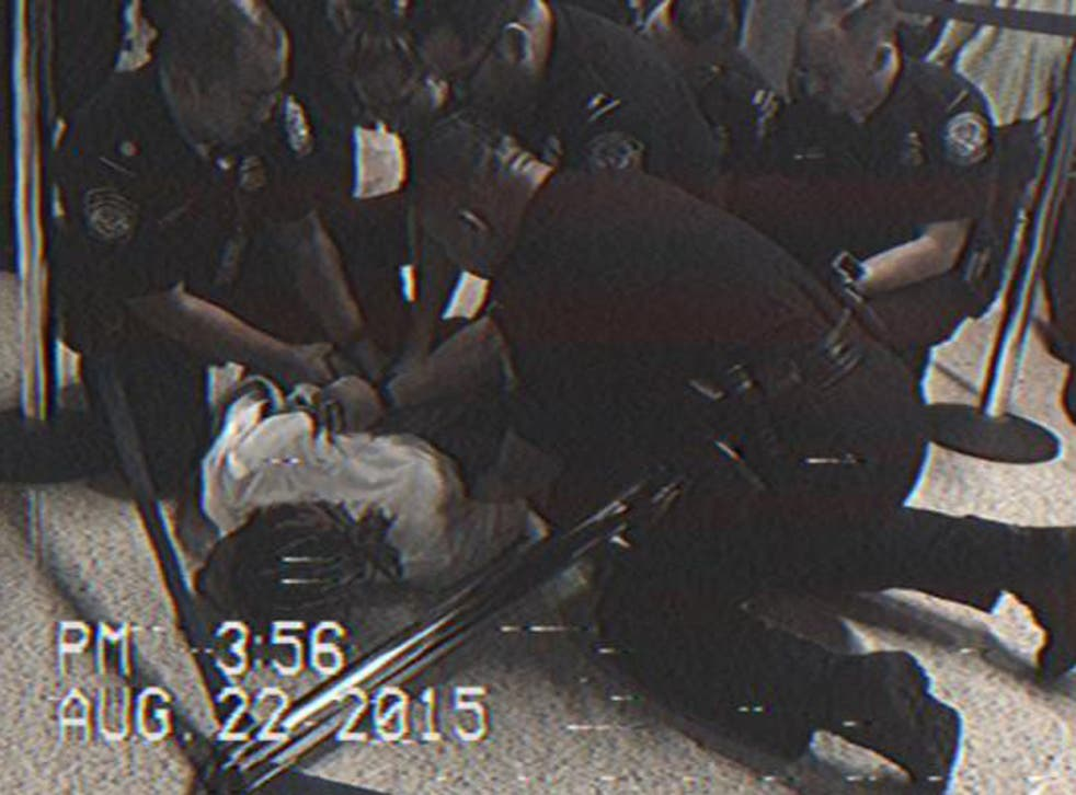 A picture Wiz Khalifa posted of himself being wrestled to the ground at LAX
