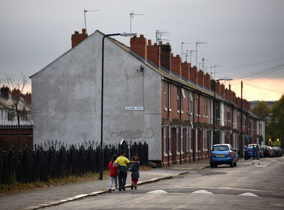 Children walk along a street in the Eastwood area of Rotherham, South Yorkshire,