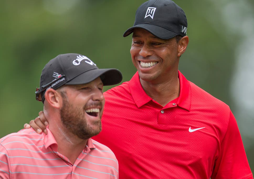 fb1b096e6954 Tiger Woods congratulates his playing partner Scott Brown (left) after a  hole-in