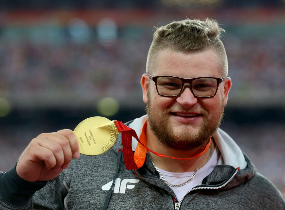 Pawel Fajdek shows off his gold medal in the hammer