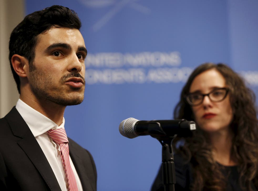 Gay Syrian refugee Subhi Nahas (L) speaks as Jessica Stern, Executive Director of the International Gay & Lesbian Human Rights Commission (R) looks on, at a news conference at the United Nations headquarters in New York,