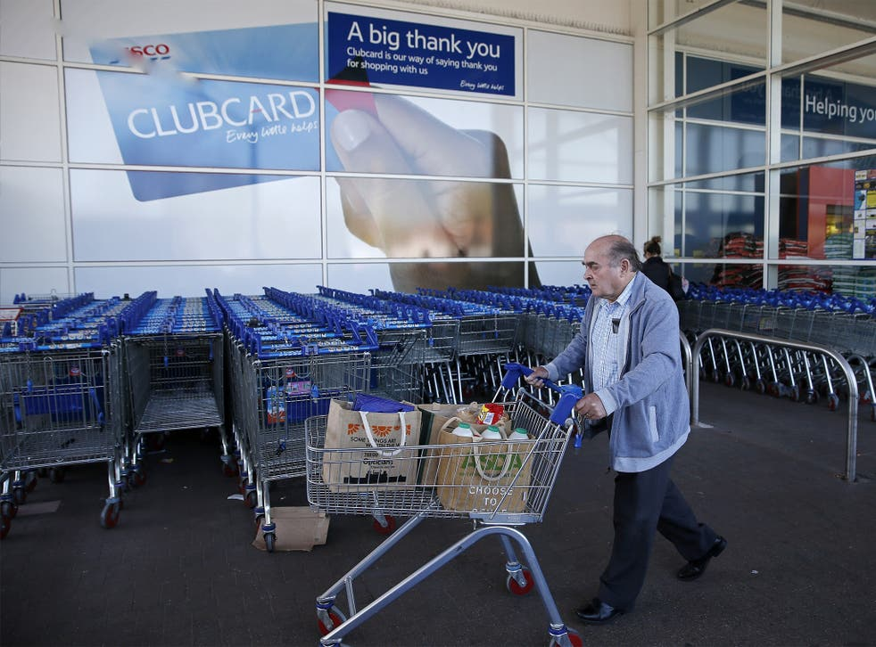 A man shops at a Tesco supermarket in Sunbury-on-Thames in Surrey