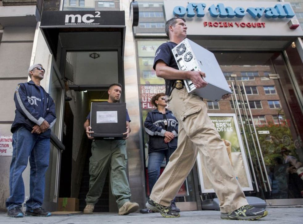 Law enforcement officers seize evidence from the Manhattan offices of Rentboy.com in New York