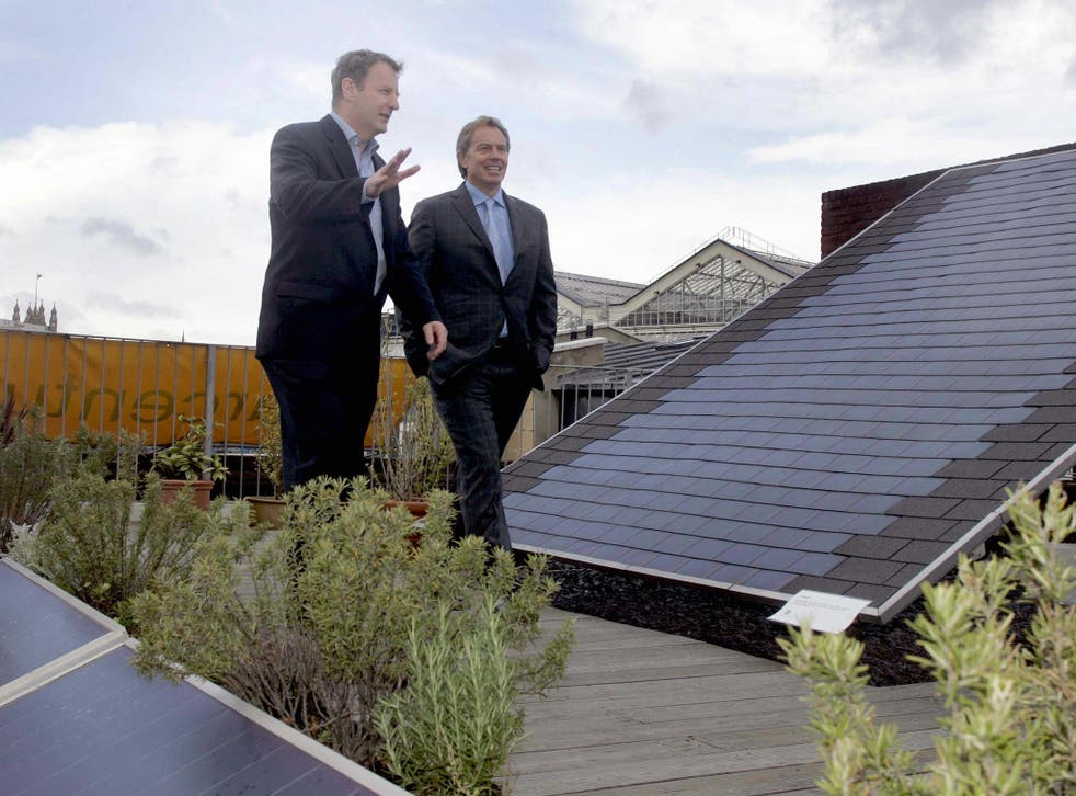 Ex-Prime Minister Tony Blair inspects solar roof panels at a time when the governent was more inclined to see them as a viable source of green energy