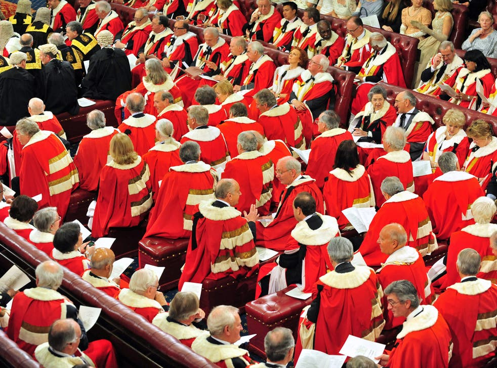 Peers and guests wait in the House of the Lords as Britain's Queen Elizabeth II arrives  to deliver a speech  during the State Opening of Parliament