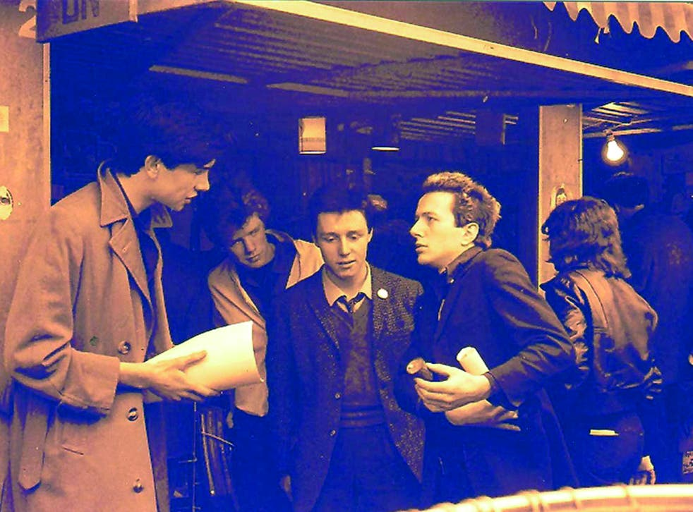 The Rock On stall at Soho market with Joe Strummer, Adrian Thrills and members of the Pop Group, early 1979