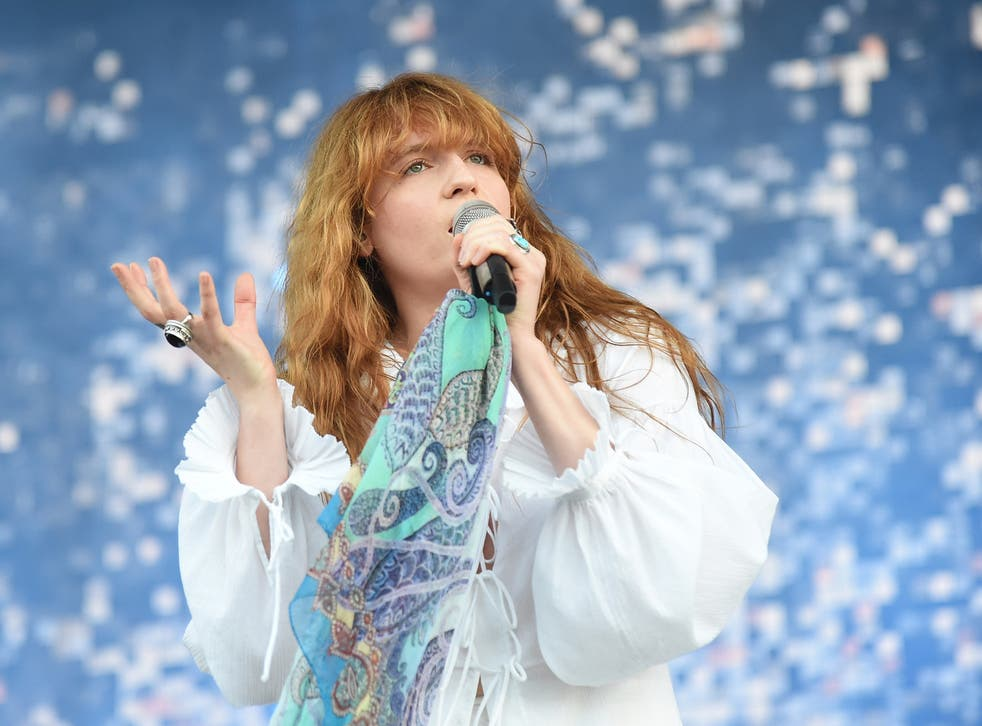 Florence and the Machine performs onstage
