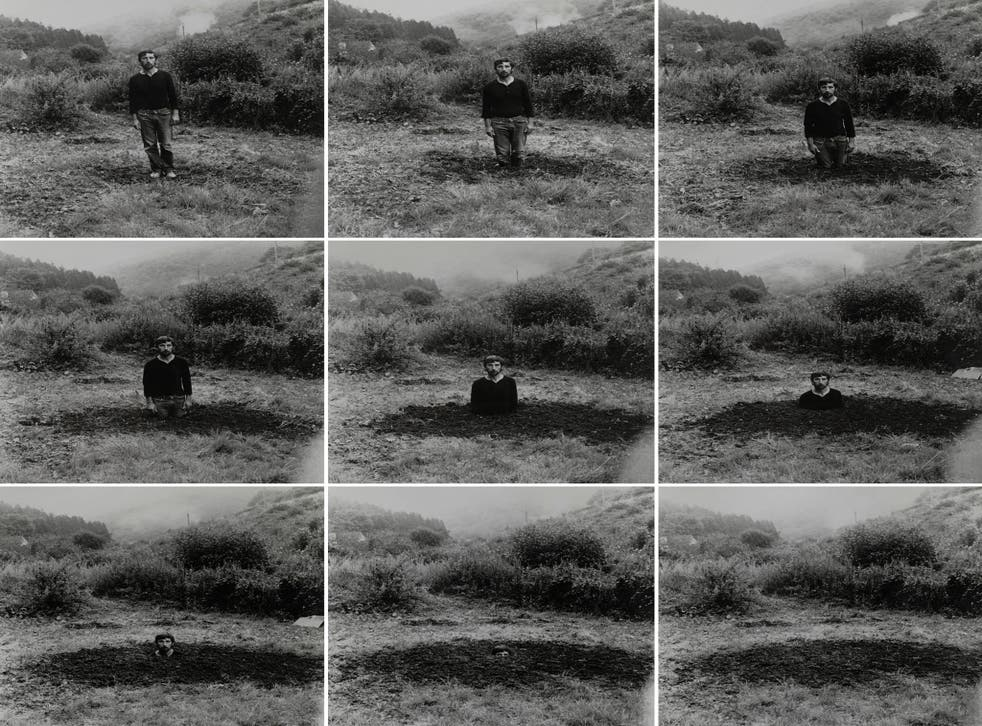 Included in a new exhibition about Arnatt is his 1969 self-portrait series 'Self-Burial'