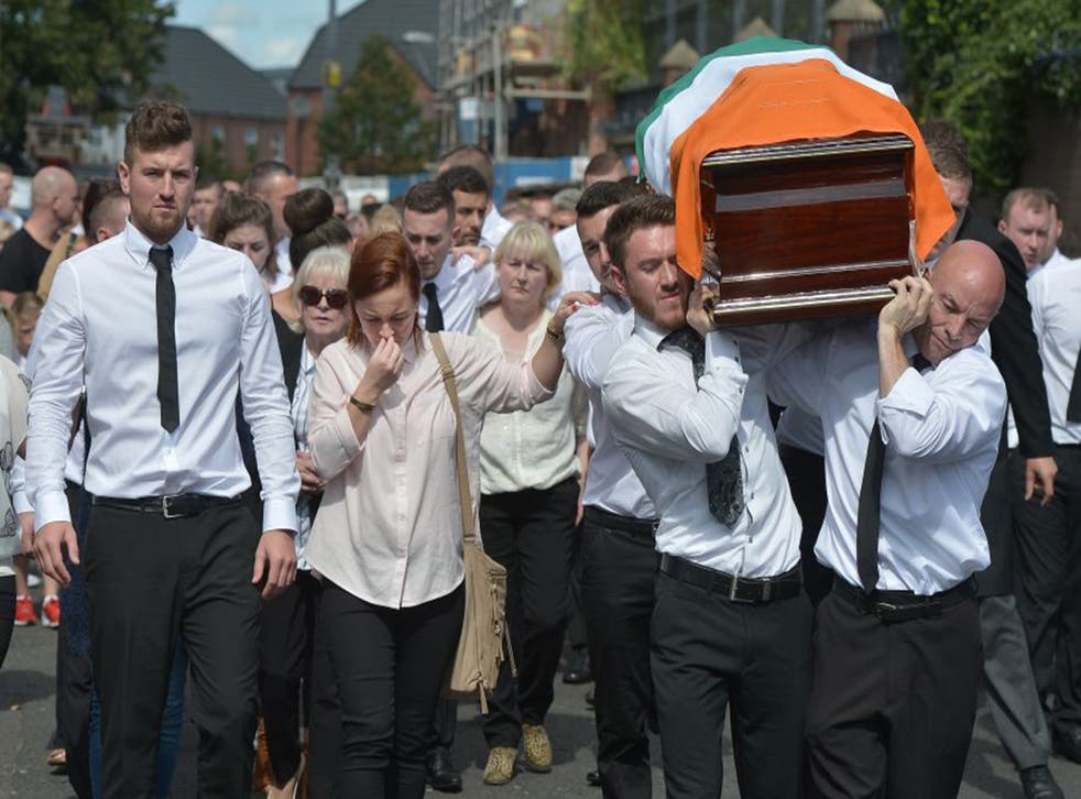 The funeral of the former IRA member Kevin McGuigan, who was shot outside his home earlier this month