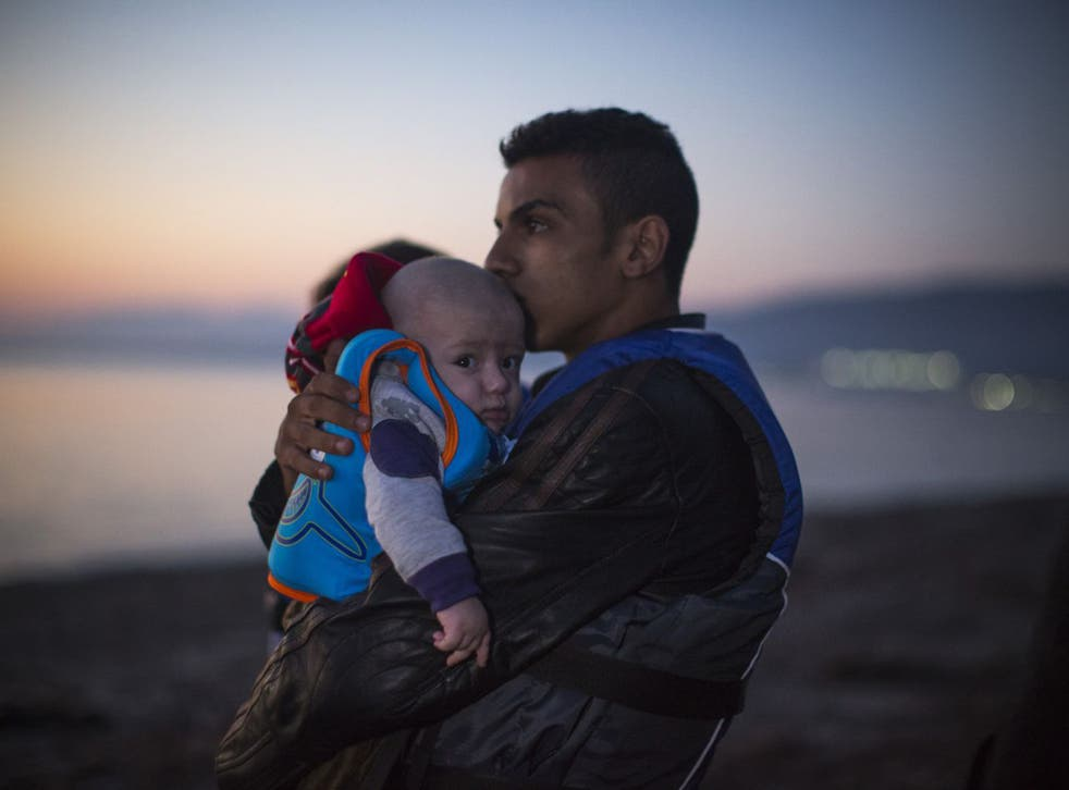 Two of the Syrian migrants who arrived by inflatable dinghy on Kos island from Turkey yesterday, at dawn