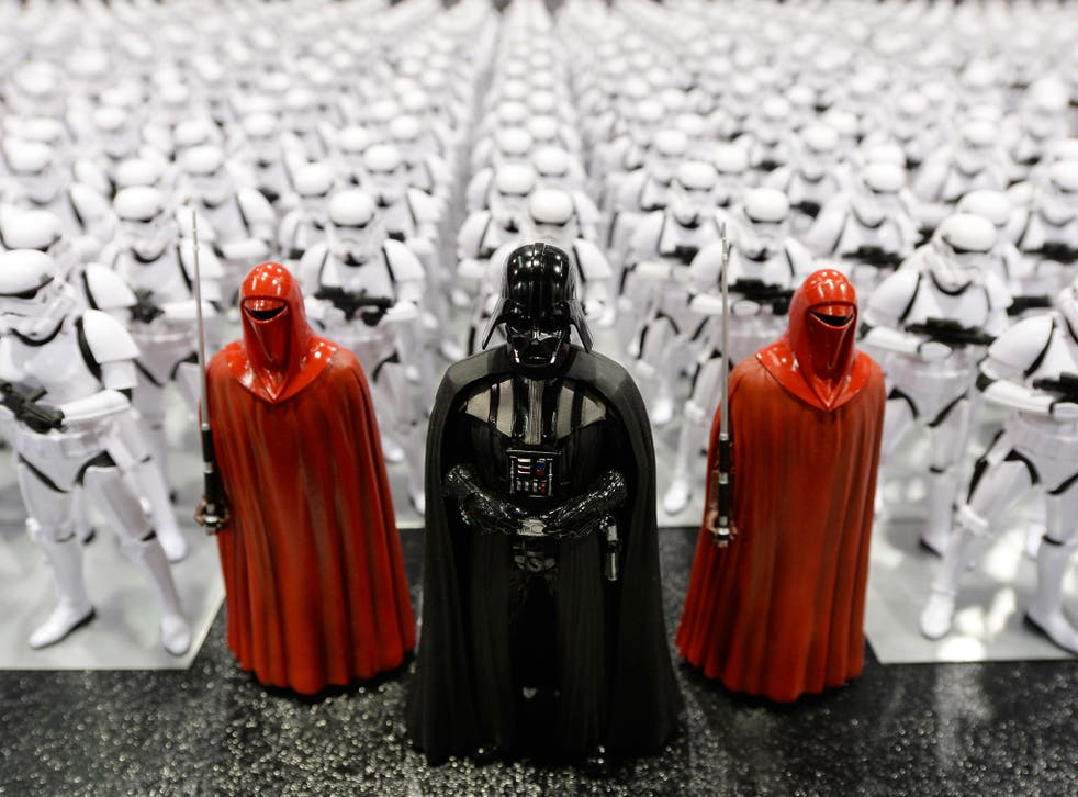 Darth Vader (C) and Stormtrooper figurines are displayed during the kick-off event of Disney's Star Wars Celebration 2015 (Getty)