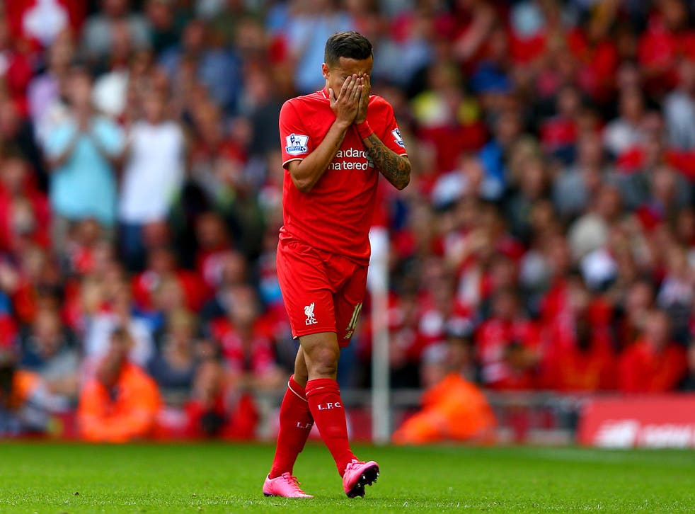 Philippe Coutinho dejectedly walks off after being shown a red card