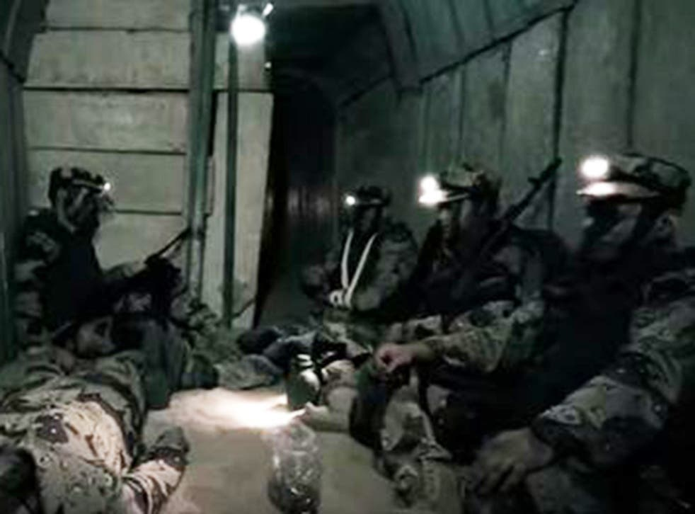 Hamas fighters pictured in the reported tunnel