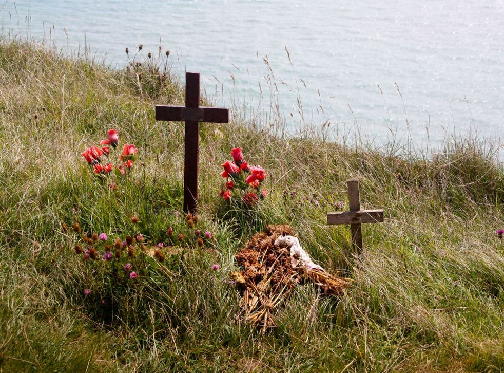 Shrine of cross and flowers at Beachy Head cliff top the third most used suicide spot in the world