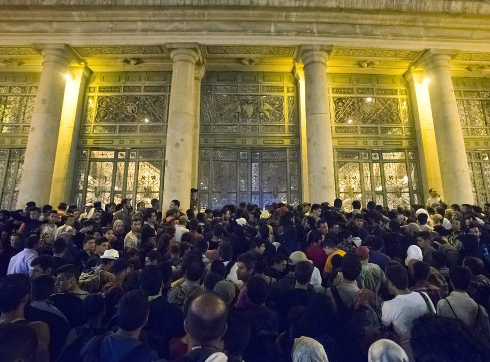 Migrants wait to board a train to Germany at the Keleti Railway Station in Budapest, Hungary, 1 September 2015