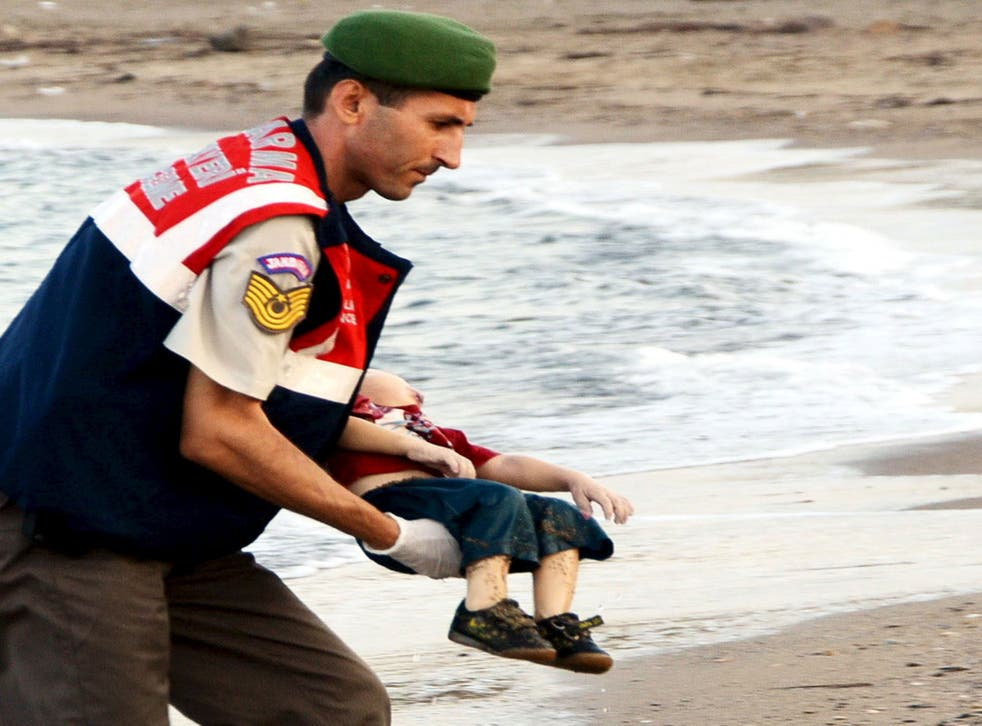 A Turkish rescue worker carries the young boy, who drowned during a failed attempt to sail to the Greek island of Kos (Reuters)