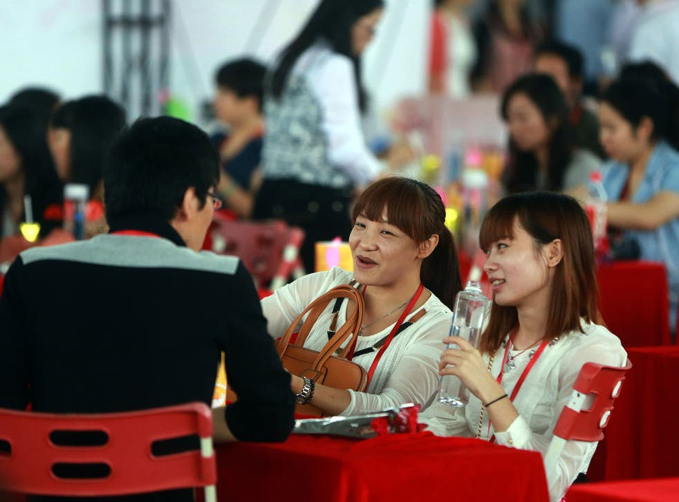 Men often have more than one girlfriend in Dongguan, China