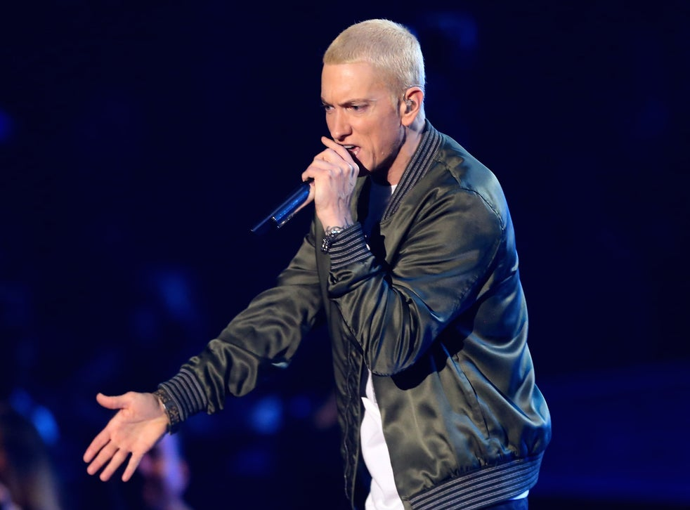 Eminem performs onstage at the 2014 MTV Movie Awards in Los Angeles.