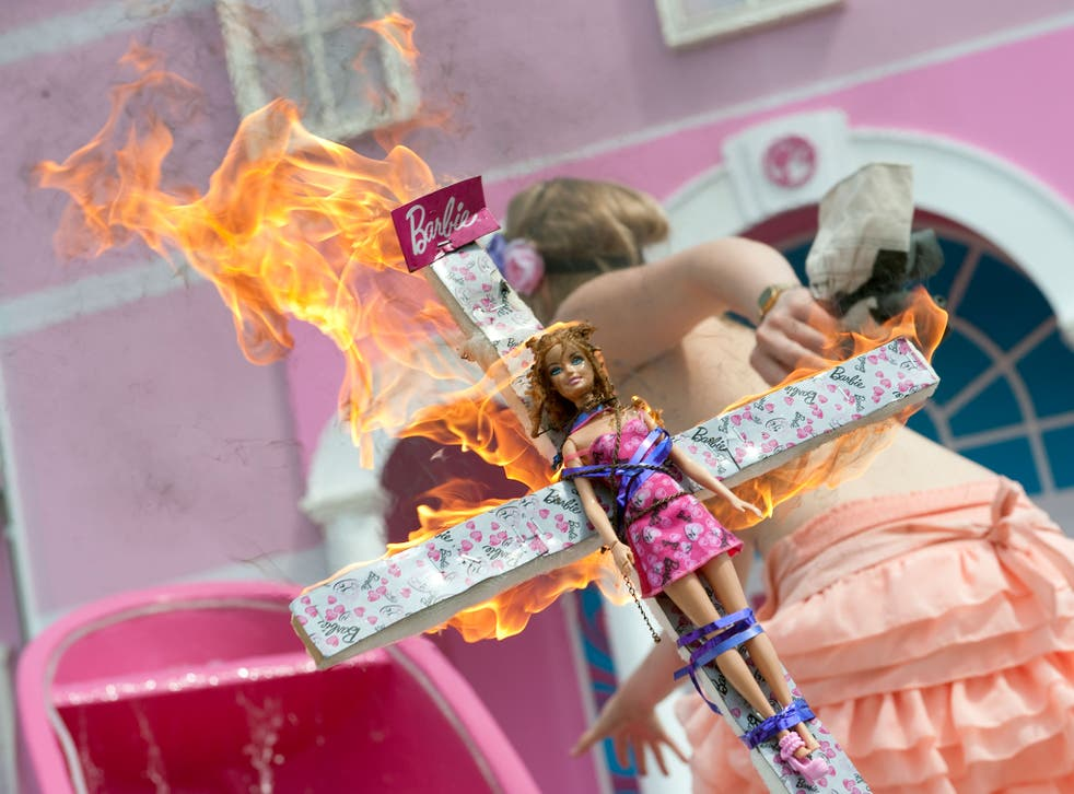 A Femen activist takes extreme action to demonstrate against the sexism of toys such as Barbie