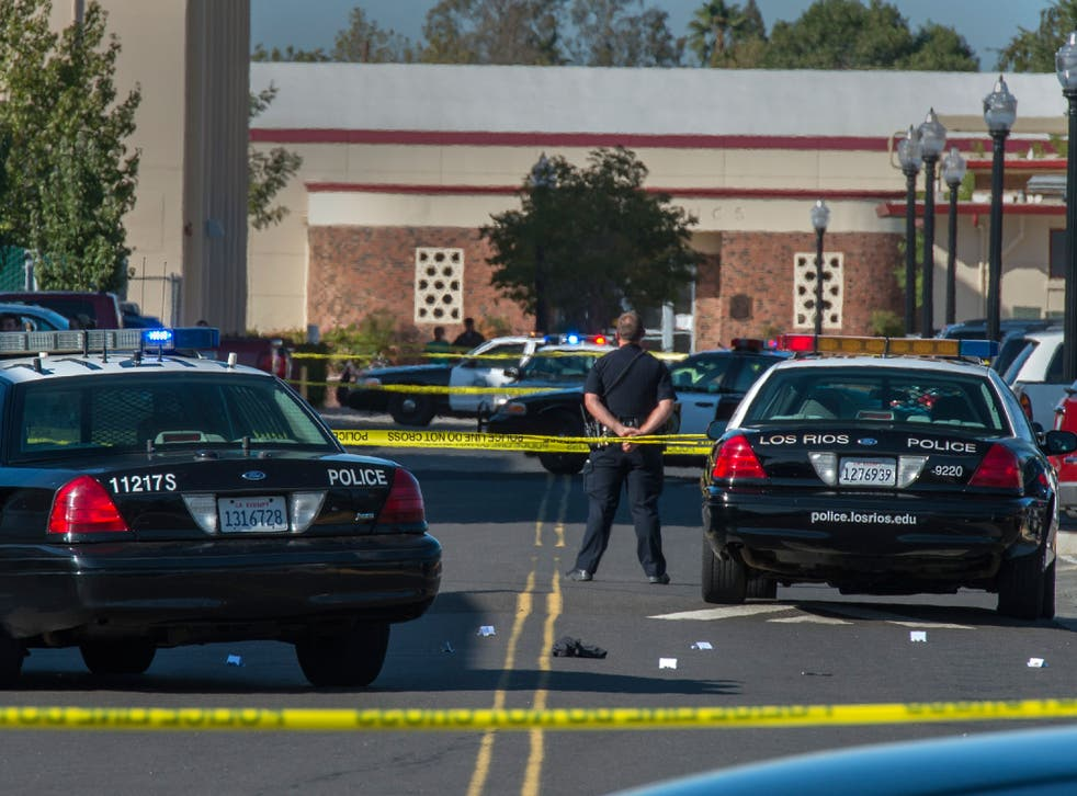 A police officer stands guard at Sacramento City College following the fatal shooting