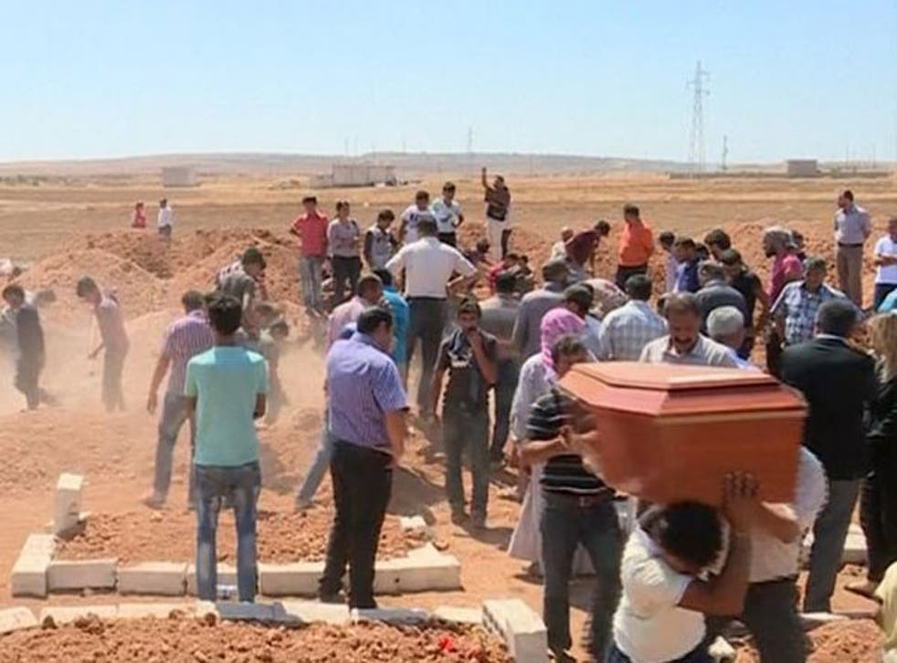 Dozens of mourners gathered in Kobani for the funeral