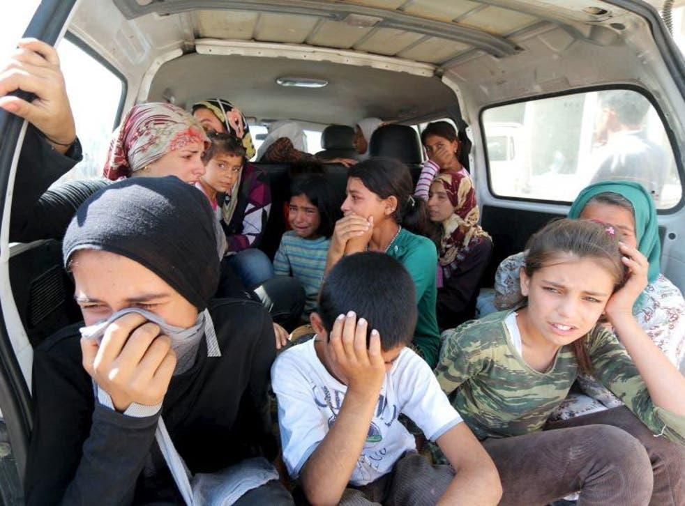 Relatives of the Kurdi family mourning in Kobani