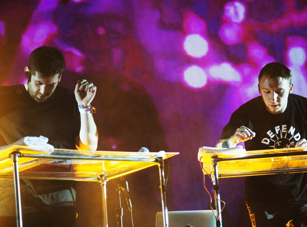 Harrison Mills and Clayton Knight of the American electronic music duo Odesza perform on day three of the Coachella Music Festival