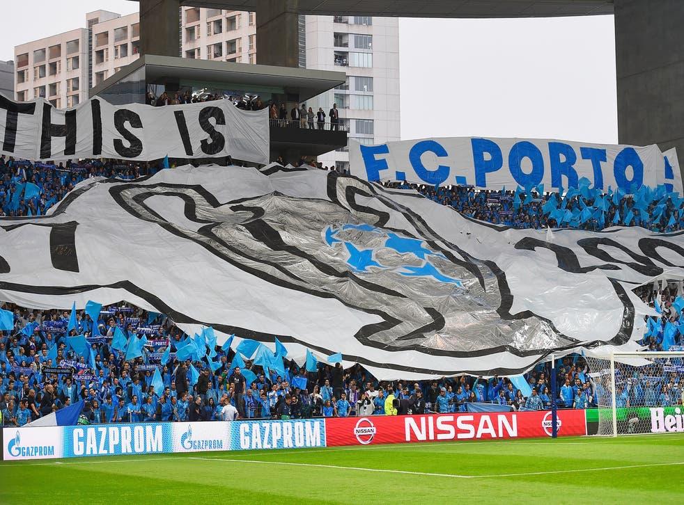FC Porto fans unfurl a banner in a Champions League tie