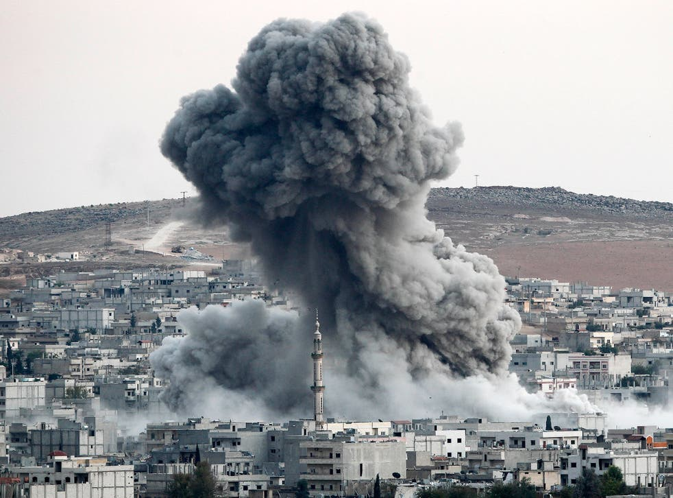 David Cameron wants to join the US-led coalition in bombing targets in Syria, such as this airstrike on Kobani, a key battleground between Isis and Syrian Kurds