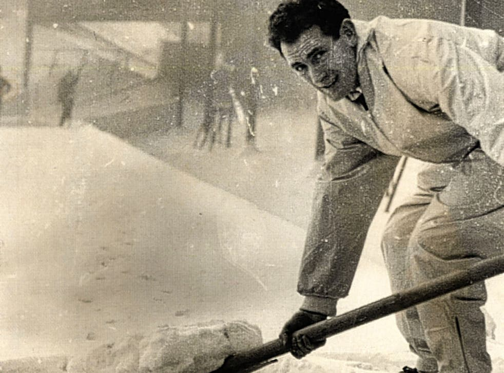 Emilio Aldecoa helps clear the St Andrew's pitch during his time as Birmingham City assistant manager in 1962