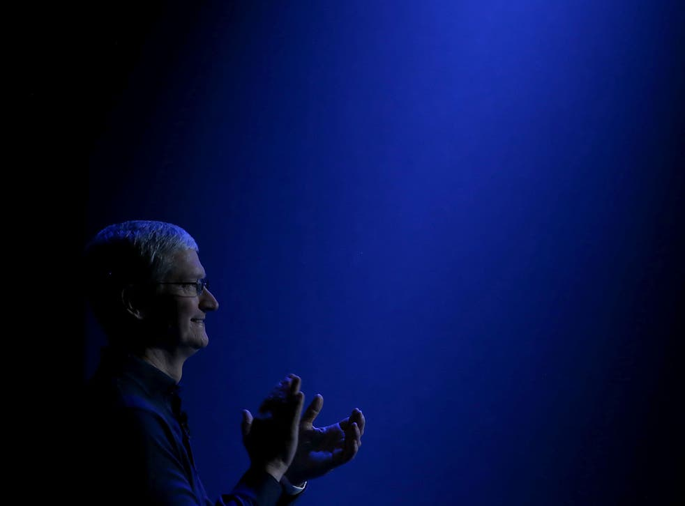 Apple CEO Tim Cook looks on as he delivers the keynote address during Apple WWDC on June 8, 2015 in San Francisco, California