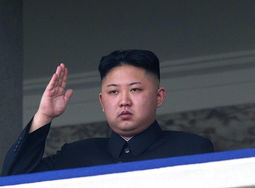 Jong-un salutes a parade in 2012