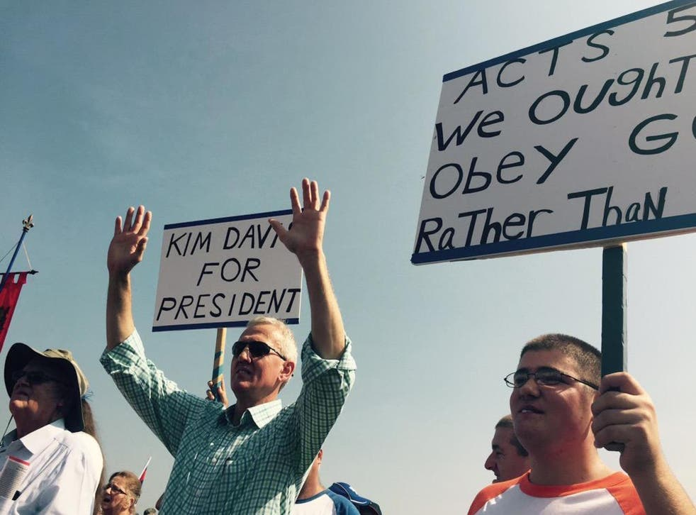 Supporters of Kim Davis hold up signs outside the Carter County Detention Center.