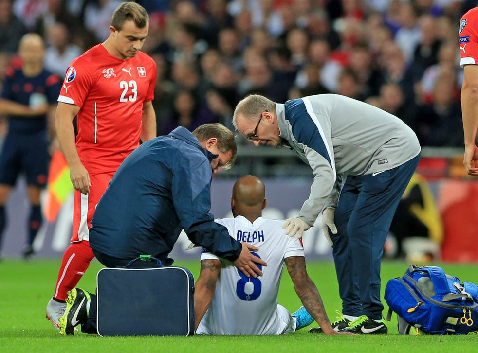 Fabian Delph receives treatment on the pitch