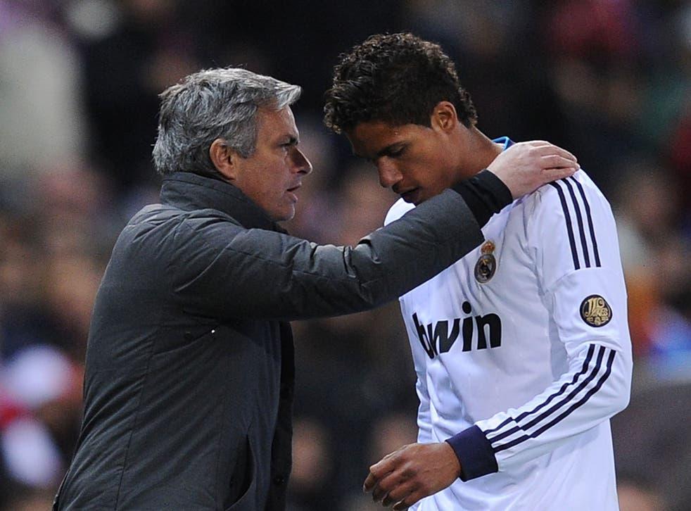 Jose Mourinho with Raphael Varane