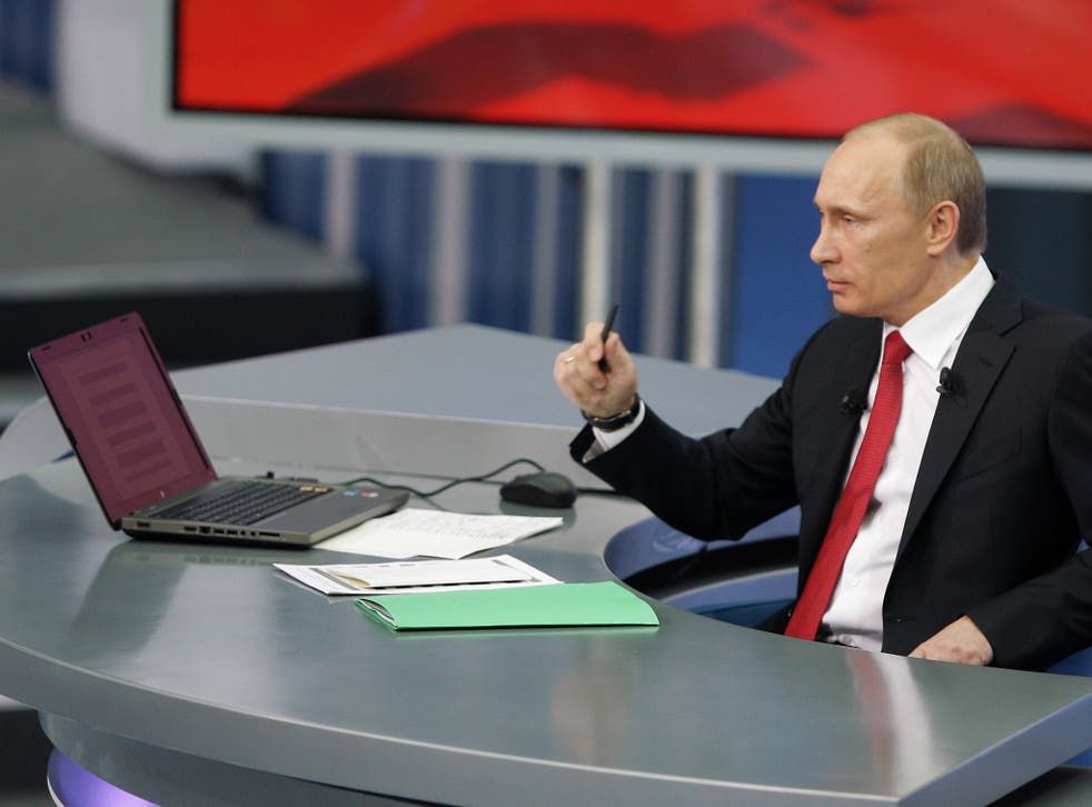 Russian Prime Minister Vladimir Putin speaks during his annual TV marathon question-and-answer session with Russians in Moscow, on December 16, 2010
