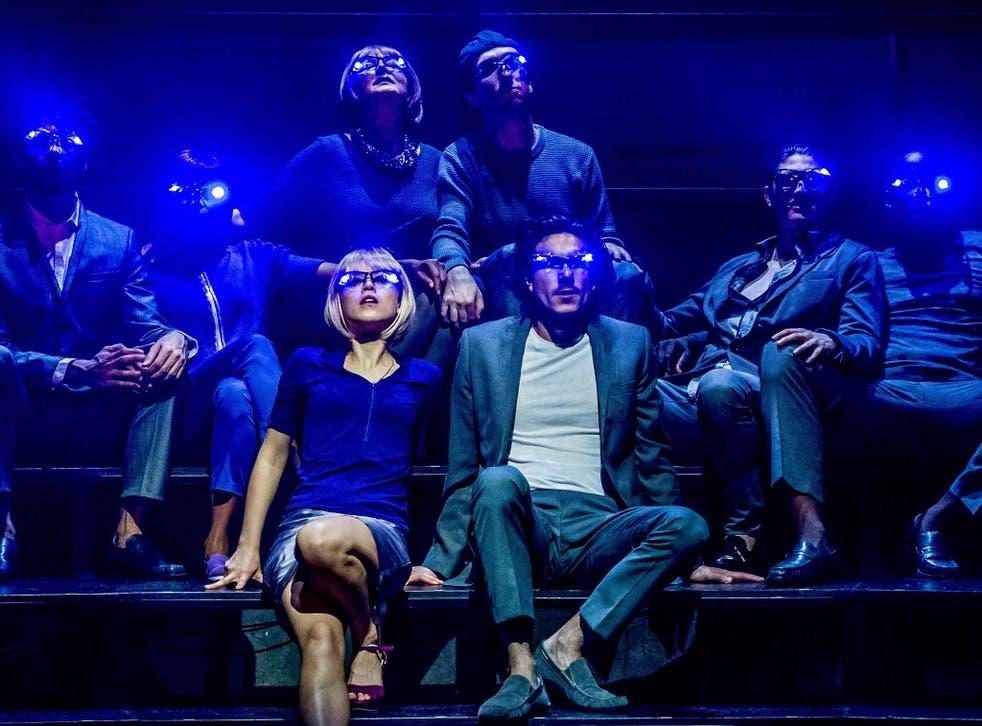 Olivia Morgan as Lenina and William Postlethwaite as John the Savage, with ensemble