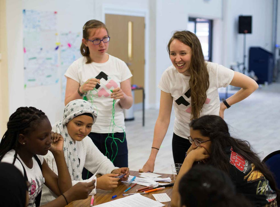 Jessy McCabe (left, standing) with Fearless Futures CEO Hanna McCloskey (right)