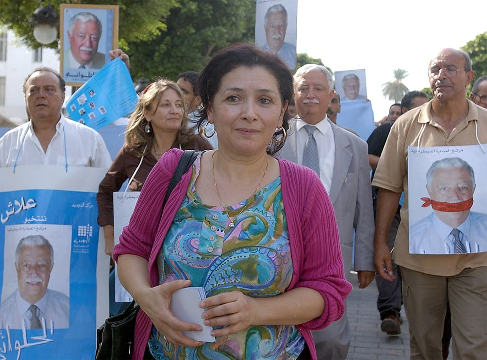 The human-rights activist Sihem Bensedrine and supporters of the electoral candidate Mohamed Ali Halouani protest against the former Tunisian President Zine Ben Ali in 2004