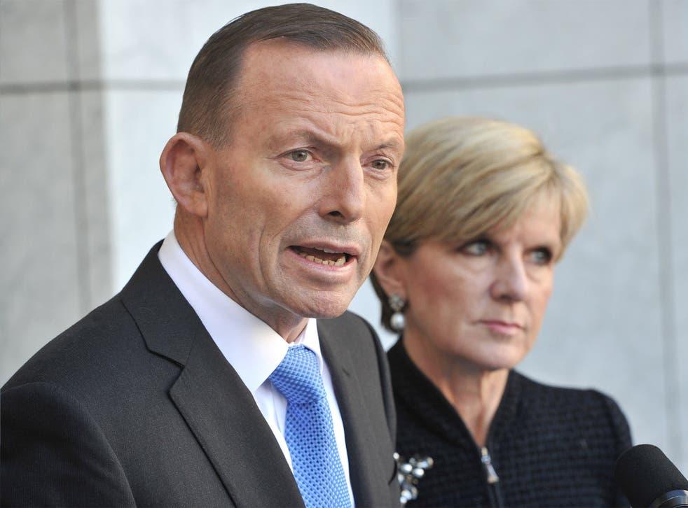 Australian Prime Minister Tony Abbott speaks to the media outside Parliament House in Canberra