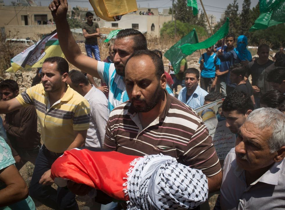 Surrounded by his relatives, the body of the 18 month old baby Ali Saad-Dawabsheh is carried during his funeral