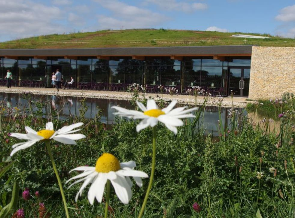Go green: Gloucester Services' grass roof is patched with solar panels