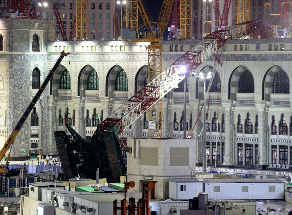The crane collapsed through a third floor roof of the holy site (AP)