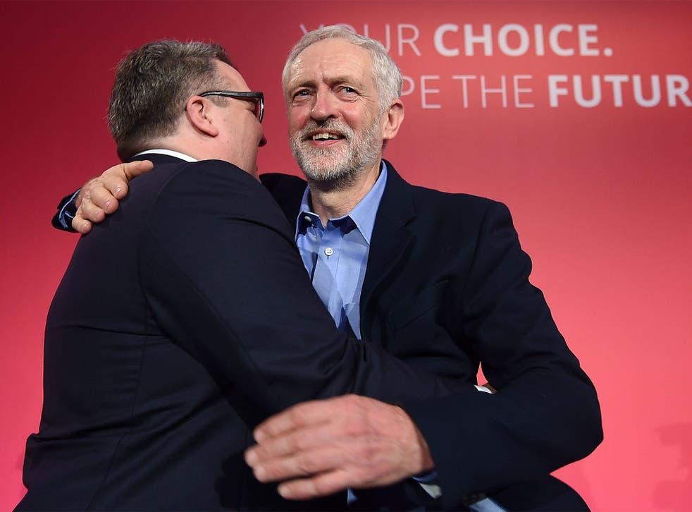 New deputy leader Tom Watson embraces Jeremy Corbyn as the pair celebrate victory