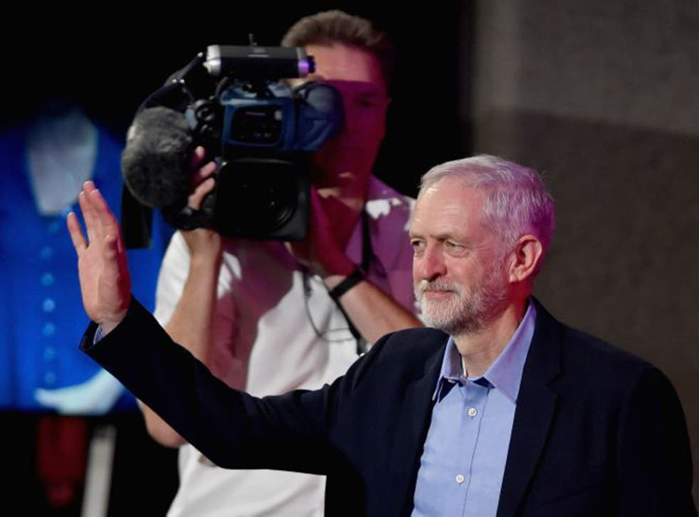 Jeremy Corbyn receives congratulations as his victory is announced