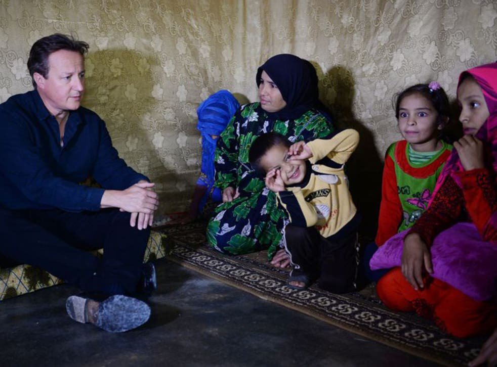 David Cameron visited Syrian refugee families at a camp in the Bekaa Valley on Monday