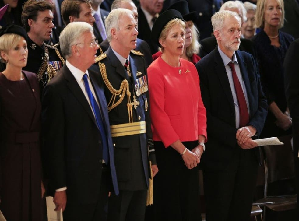Leader of the Labour Party Jeremy Corbyn (right) stands as the national anthem is sung during a service at St Paul's Cathedral in London to mark the 75th anniversary of the Battle of Britain.